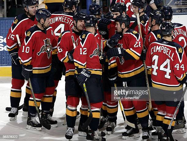 Olli Jokinen of the Florida Panthers celebrates with teammates after scoring the gamewinning goal in overtime against the Chicago Blackhawks at the...