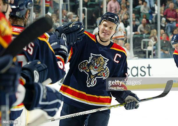 Olli Jokinen of the Florida Panthers is congratulated by teammates after assisting on a goal against the Nashville Predators on December 13, 2005 at...