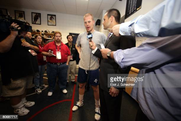 Olli Jokinen of the Florida Panthers is interviewed in the locker room after the game against the Washington Capitals at the Bank Atlantic Center on...