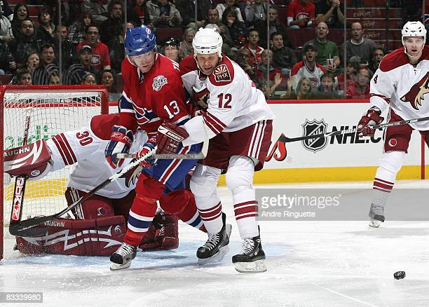 Olli Jokinen of the Phoenix Coyotes defends against Alex Tanguay of the Montreal Canadiens in the crease at the Bell Centre on October 18 2008 in...