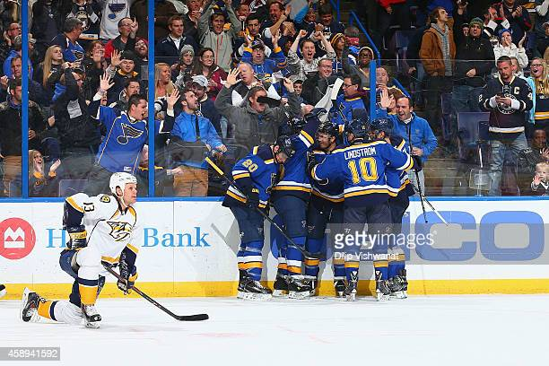Olli Jokinen of the the Nashville Predators reacts as Paul Stastny of the St Louis Blues is congratulated by teammates after scoring the gamewinning...