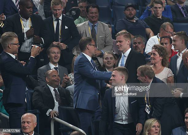 Olli Juolevi celebrates in the stands after being selected fifth overall by the Vancouver Canucks during round one of the 2016 NHL Draft at First...