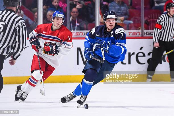 Olli Juolevi of Team Finland skates past Filip Chlapik of Team Czech Republic during the IIHF World Junior Championship preliminary round game at the...