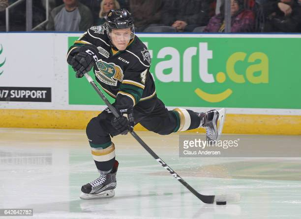 Olli Juolevi of the London Knights fires a pass against the Owen Sound Attack during an OHL game at Budweiser Gardens on February 17 2017 in London...
