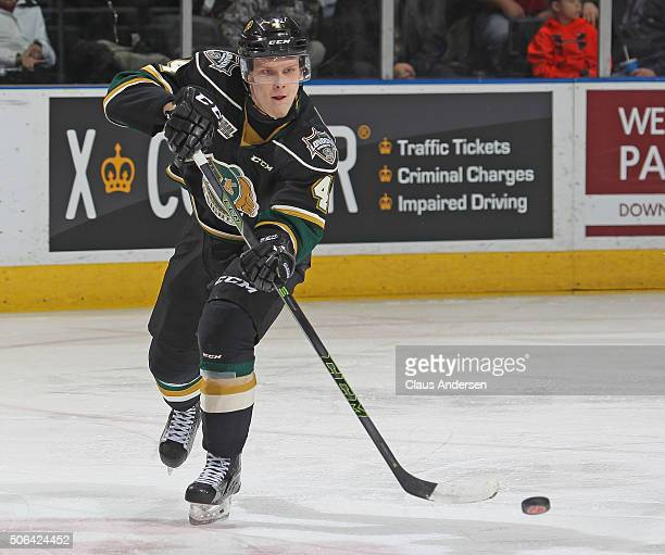 Olli Juolevi of the London Knights fires a pass against the Peterborough Petes during an OHL game at Budweiser Gardens on January 222016 in London...