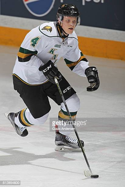 Olli Juolevi of the London Knights skates with the puck against the Peterborough Petes during an OHL game at the Peterborough Memorial Centre on...