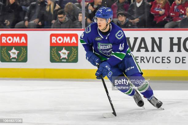 Olli Juolevi of the Utica Comets skating up the ice with the puck against the Laval Rocket at Place Bell on November 3 2018 in Laval Quebec