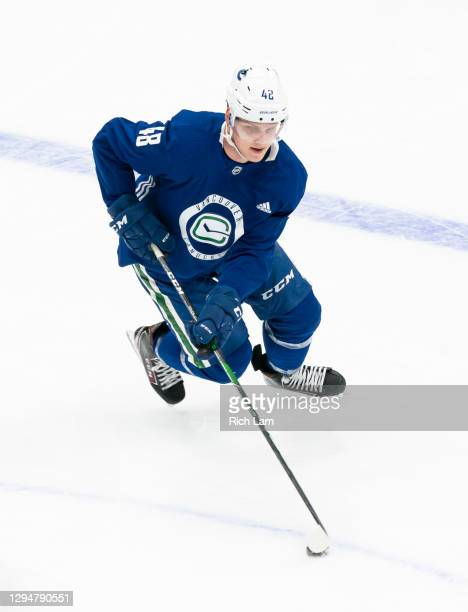 Olli Juolevi of the Vancouver Canucks skates with the puck on the first day of the Vancouver Canucks NHL Training Camp on January 2021 at Rogers...