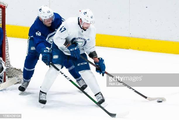 Olli Juolevi of the Vancouver Canucks tries to check Sven Baertschi off the puck during a drill on the first day of the Vancouver Canucks NHL...