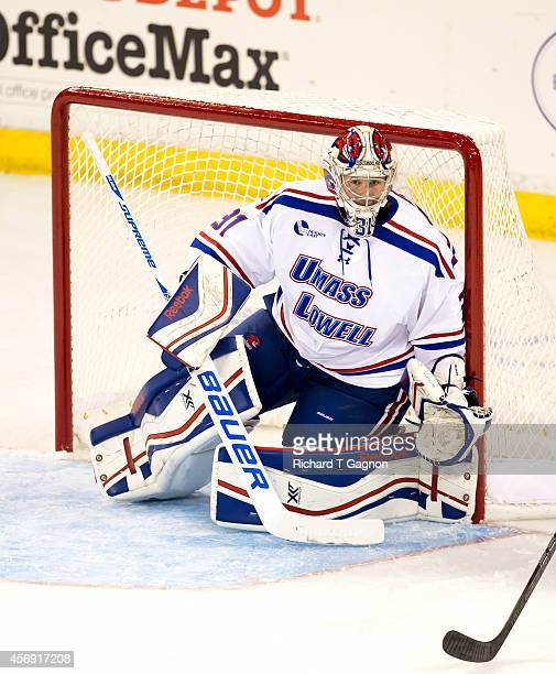Olli Kälkäjä of the Massachusetts Lowell River Hawks tends goal against the St. Thomas University Tommies during NCAA exhibition hockey at the...