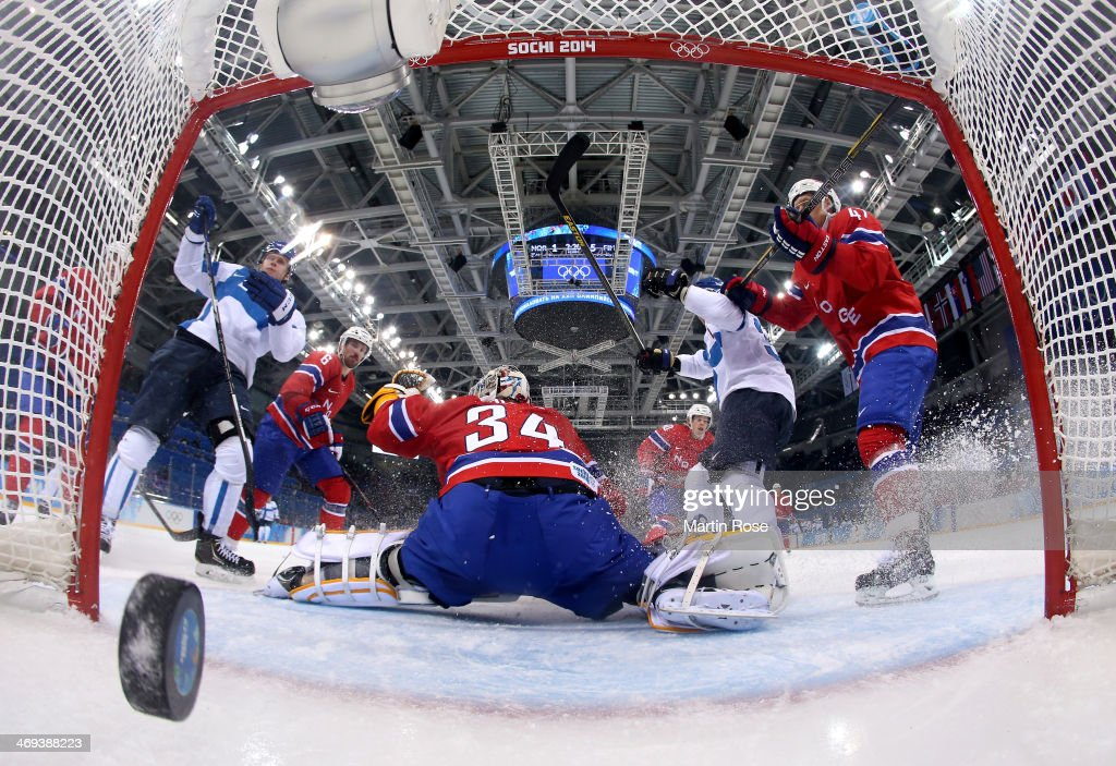 Olli Maatta #3 of Finland scores against Lars Volden #34 of Norway in the third period during the Men's Ice Hockey Preliminary Round Group B game on day seven of the Sochi 2014 Winter Olympics at Shayba Arena on February 14, 2014 in Sochi, Russia.