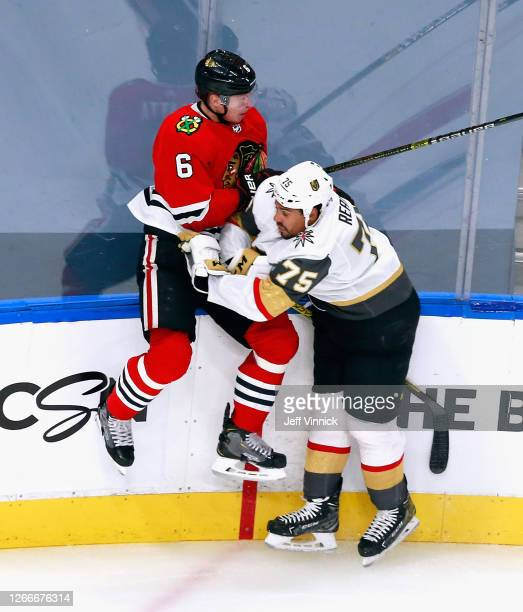 Olli Maatta of the Chicago Blackhawks is checked by Ryan Reaves of the Vegas Golden Knights during the first period in Game Four of the Western...