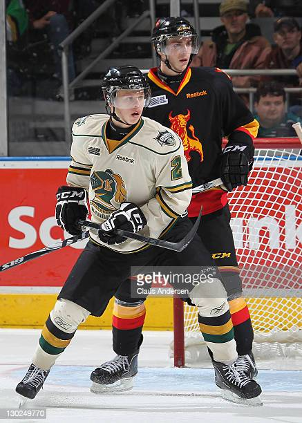 Olli Maatta of the London Knights keeps Adam Payerl of the Belleville Bulls in check in a game on October 21 2011 at the John Labatt Centre in London...