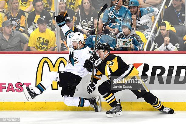 Olli Maatta of the Pittsburgh Penguins checks Joonas Donskoi of the San Jose Sharks in Game Two of the 2016 NHL Stanley Cup Final at Consol Energy...