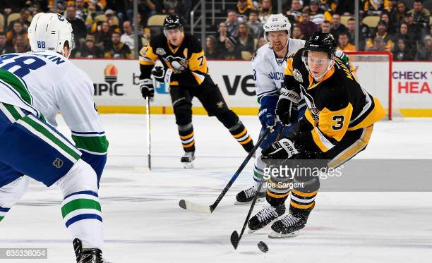 Olli Maatta of the Pittsburgh Penguins handles the puck against the Vancouver Canucks at PPG Paints Arena on February 14 2017 in Pittsburgh...