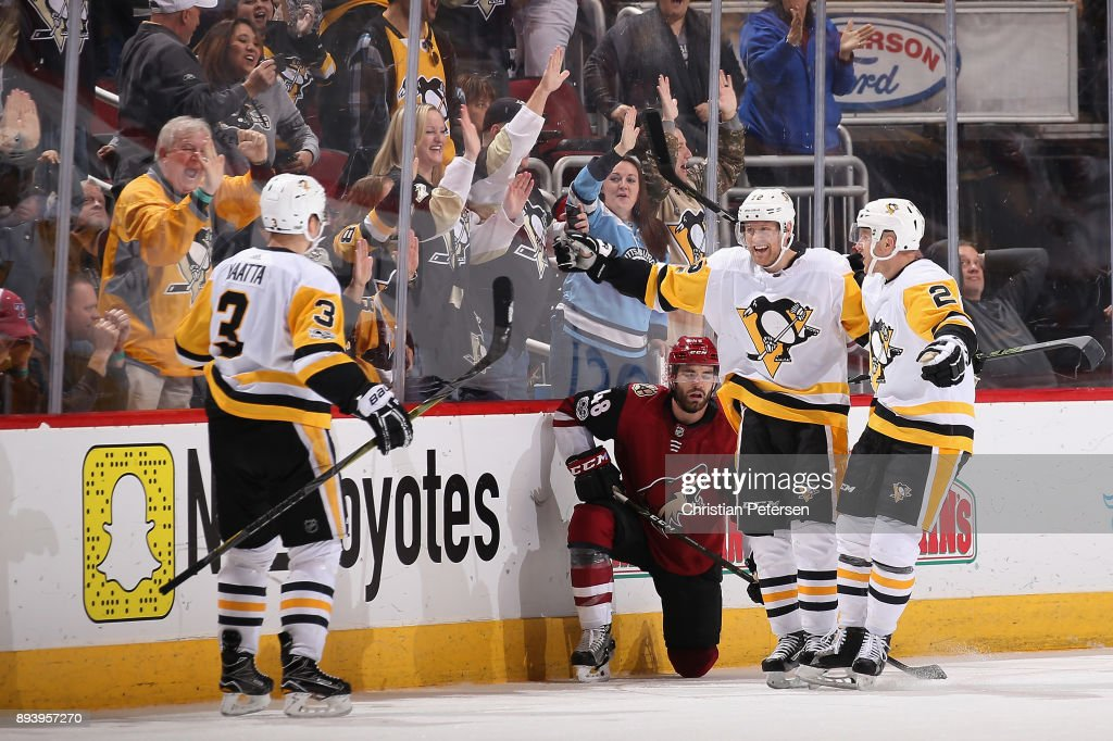Olli Maatta #3, Patric Hornqvist #72 and Chad Ruhwedel #2 of the Pittsburgh Penguins celebrate after Maatta scored the game winning goal against the Arizona Coyotes during the third period of the NHL game at Gila River Arena on December 16, 2017 in Glendale, Arizona. The Penguins defeated the Coyotes 4-2.