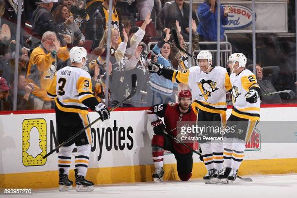 Olli Maatta Patric Hornqvist and Chad Ruhwedel of the Pittsburgh Penguins celebrate after Maatta scored the game winning goal against the Arizona...
