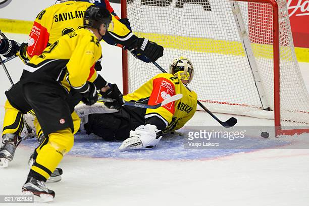 Olli Palola of Vaxjo Lakers scores to 2-1 behind Jussi Markkanen of SaiPa Lappeenranta during the Champions Hockey League Round of 16 match between...