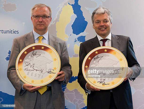 Olli Rehn the European Union's economic and monetary affairs commissioner left and Didier Reynders Belgium's finance minister hold the new Estonian...