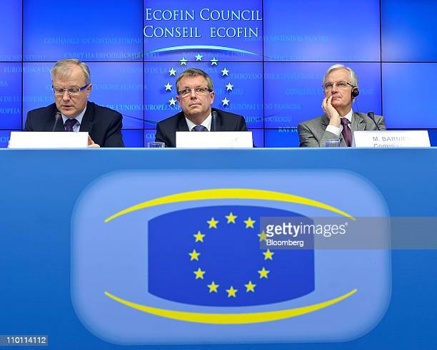 Olli Rehn the European Union's economic and monetary affairs commissioner left sits with Gyorgy Matolcsy Hungary's finance minister center and Michel...