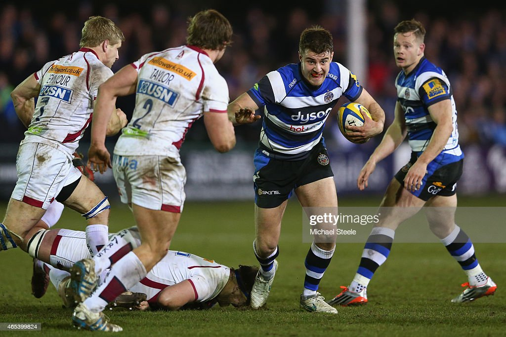 Ollie Devoto of Bath makes a break as Dan Braid (L) and Sam Tuitupou of Sale close in during the Aviva Premiership match between Bath Rugby and Sale at the Recreation Ground on March 6, 2015 in Bath, England.