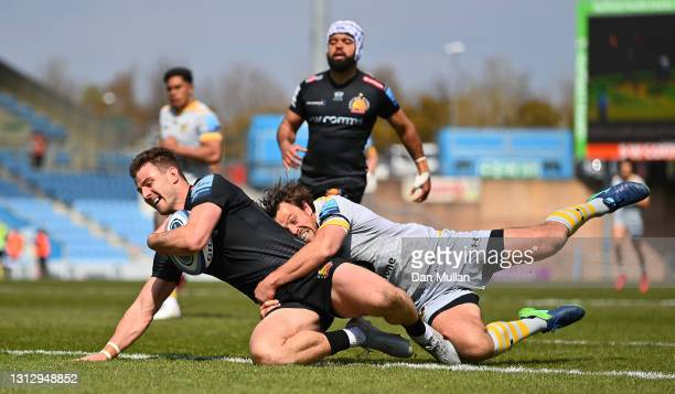 Ollie Devoto of Exeter Chiefs scores his side's first try as he is tackled by Rob Miller of Wasps during the Gallagher Premiership Rugby match...