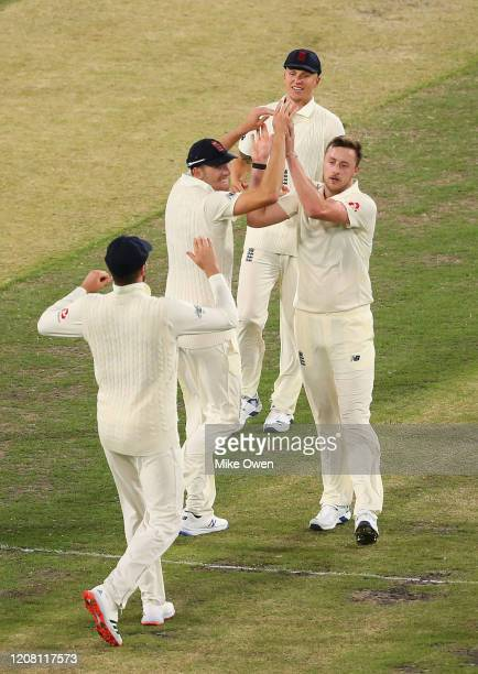Ollie E Robinson of the England Lions celebrates after dismissing Moises Henriques of Australia A during the Four Day match between Australia A and...