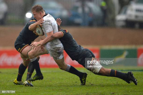 Ollie Fox of England tackled by Taine Basham of Wales during the U19 International Series match between England and Wales at Paarl Gymnasium on...