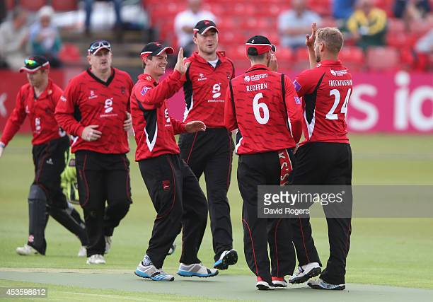 Ollie Freckingham of Leicestershire is congratulated by team mates after bowling Tom KohlerCadmore during the Royal London One day Cup match between...