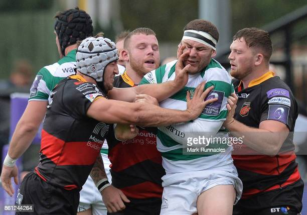 Ollie Griffiths of Dragons lashes out at Rob Vickers of Newcastle Falcons during the European Rugby Challenge Cup match between Newcastle Falcons and...