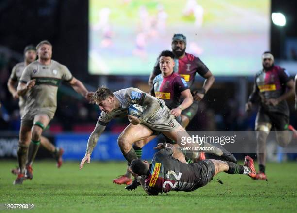 Ollie HassellCollins of London Irish is is tackled by Brett Herron of Harlequin's during the Gallagher Premiership Rugby match between Harlequins and...