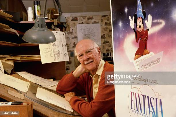 Ollie Johnston an animator who worked on Disney's Fantasia sits inside his studio next to a promotional movie poster