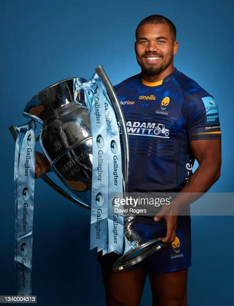 Ollie Lawrence of Worcester Warriors poses for a photo with the Gallagher Premiership Trophy during the Gallagher Premiership Rugby Season Launch at...