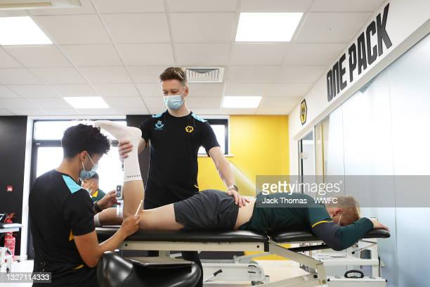 Ollie Leaper, Physio of Wolverhampton Wanderers and Carlos Sales take the measurements of Andreas Sondergaard of Wolverhampton Wanderers at Sir Jack...