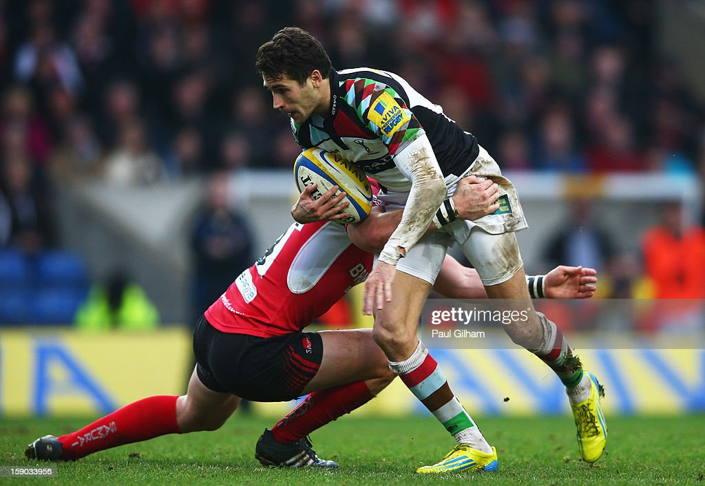Ollie Lindsay-Haue of Harlequins is tackled by Rob Lewis of London Welsh during the Aviva Premiership match between London Welsh and Harlequins at Kassam Stadium on January 6, 2013 in Oxford, England.