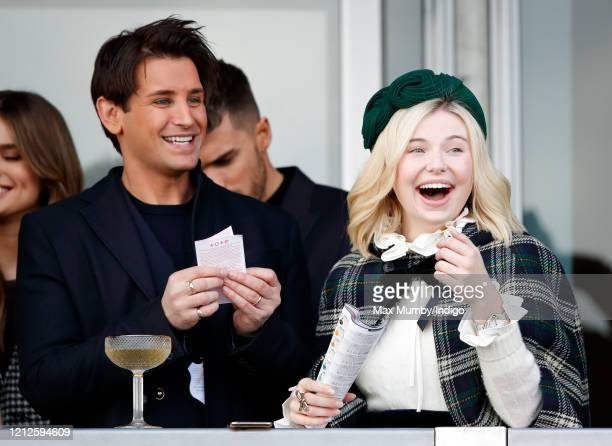 Ollie Locke and Georgia Toffolo attend day 4 'Gold Cup Day' of the Cheltenham Festival 2020 at Cheltenham Racecourse on March 13 2020 in Cheltenham...