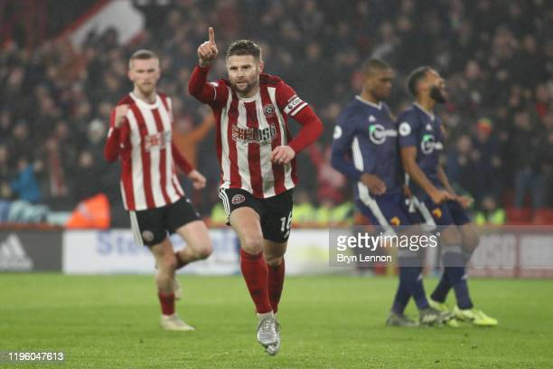 Ollie Norwood of Sheffield United celebrates after scoring his team's first goal from the penalty spot during the Premier League match between...