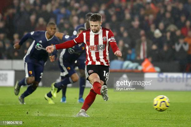 Ollie Norwood of Sheffield United scores his team's first goal from the penalty spot during the Premier League match between Sheffield United and...