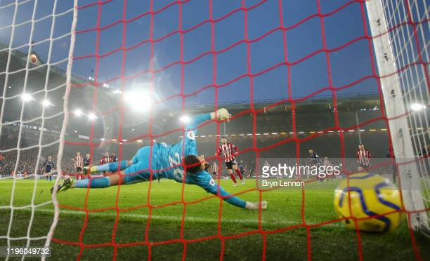 Ollie Norwood of Sheffield United scores his team's first goal from the penalty spot past Ben Foster of Watford during the Premier League match...