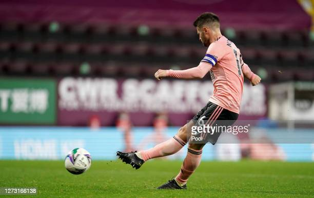 Ollie Norwood of Sheffield United takes a penalty in the shootout during the Carabao Cup second round match between Burnley and Sheffield United at...