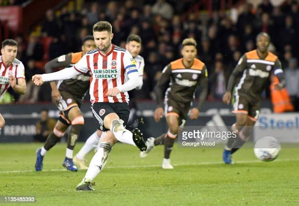 Ollie Norwood scores Sheffield United scores his team's first goal from the penalty spot during the Sky Bet Championship match between Sheffield...