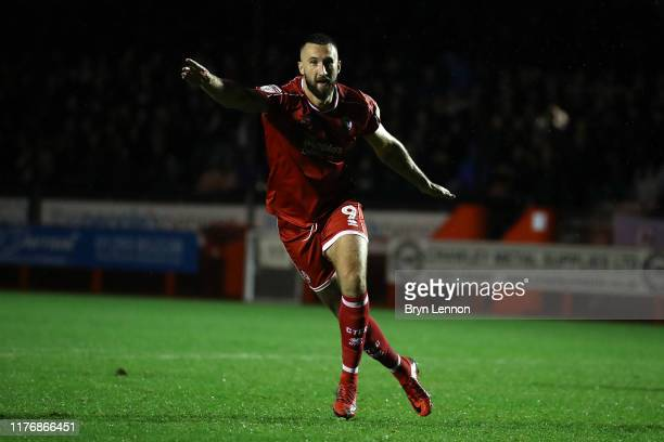 Ollie Palmer of Crawley Town celebrates scoring the winning penalty during the Carabao Cup Third Round match between Crawley Town and Stoke City at...