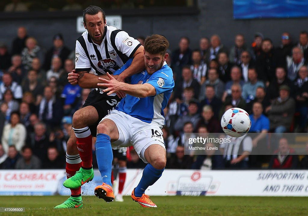Ollie Palmer of Grimsby Town and Will Evans of Eastleigh challenge for the ball during the Vanarama Football Conference League match between Grimsby Town and Eastleigh FC at Blundell Park on May 3, 2015 in Grimsby, England.