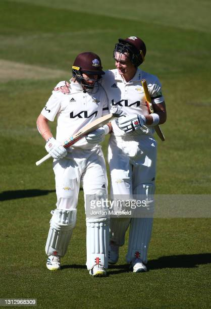 Ollie Pope and Jamie Smith of Surrey make their way off the field during day three of the LV= Insurance County Championship match between Surrey and...