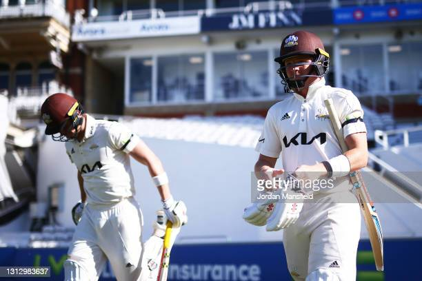 Ollie Pope and Jamie Smith of Surrey make their way to the field during day three of the LV= Insurance County Championship match between Surrey and...