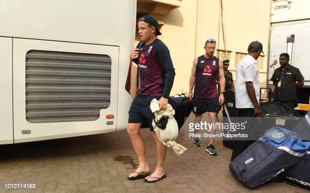 Ollie Pope and Paul Collingwood of England walk on to the bus after the Test series against Sri Lanka was postponed at P Sara Oval on March 13 2020...