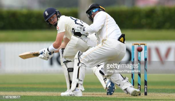 Ollie Pope of England bats watched by Tom Blundell at Cobham Oval on November 16 2019 in Whangarei New Zealand