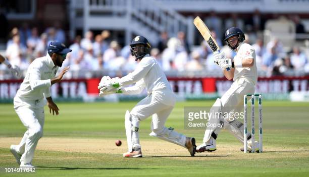 Ollie Pope of England hits past India wicketkeeper Dinesh Karthik and Ajinkya Rahane during day three of the 2nd Specsavers Test between England and...