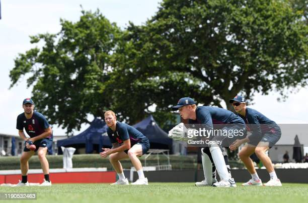 Ollie Pope of England keeps wicket alongside slipfielders Dom Sibley Ben Stokes and Joe Root during a nets session at Seddon Park on November 28 2019...