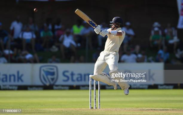 Ollie Pope of England leaps as he hits a four off the bowling of Dane Paterson during Day One of the Third Test between England and South Africa on...